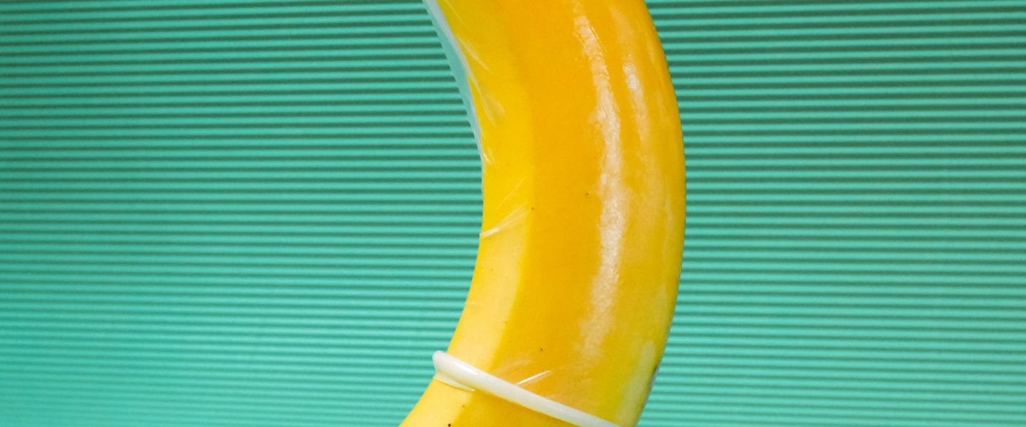 yellow banana fruit on green textile