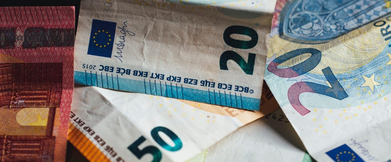 20 euro bill on white textile