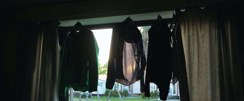 three black jackets on window