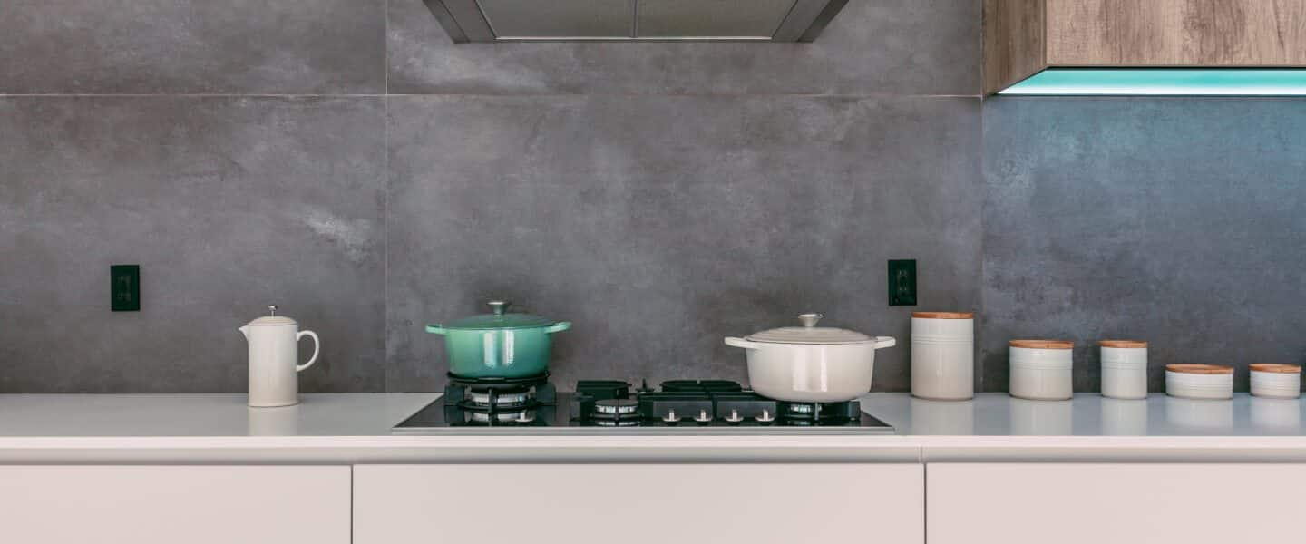 green and white casseroles on white oven