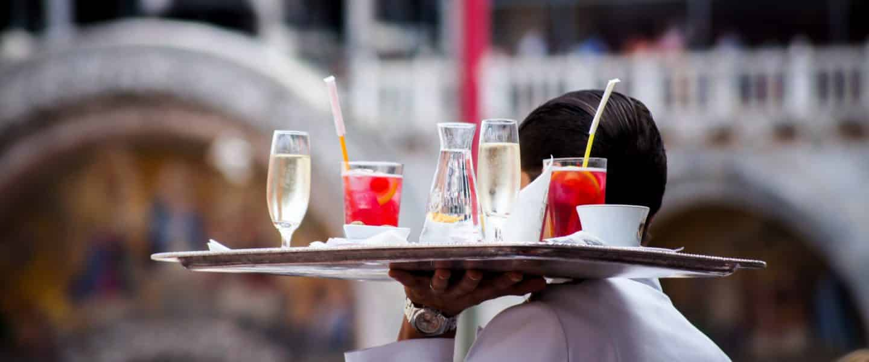 waiter serving beverages