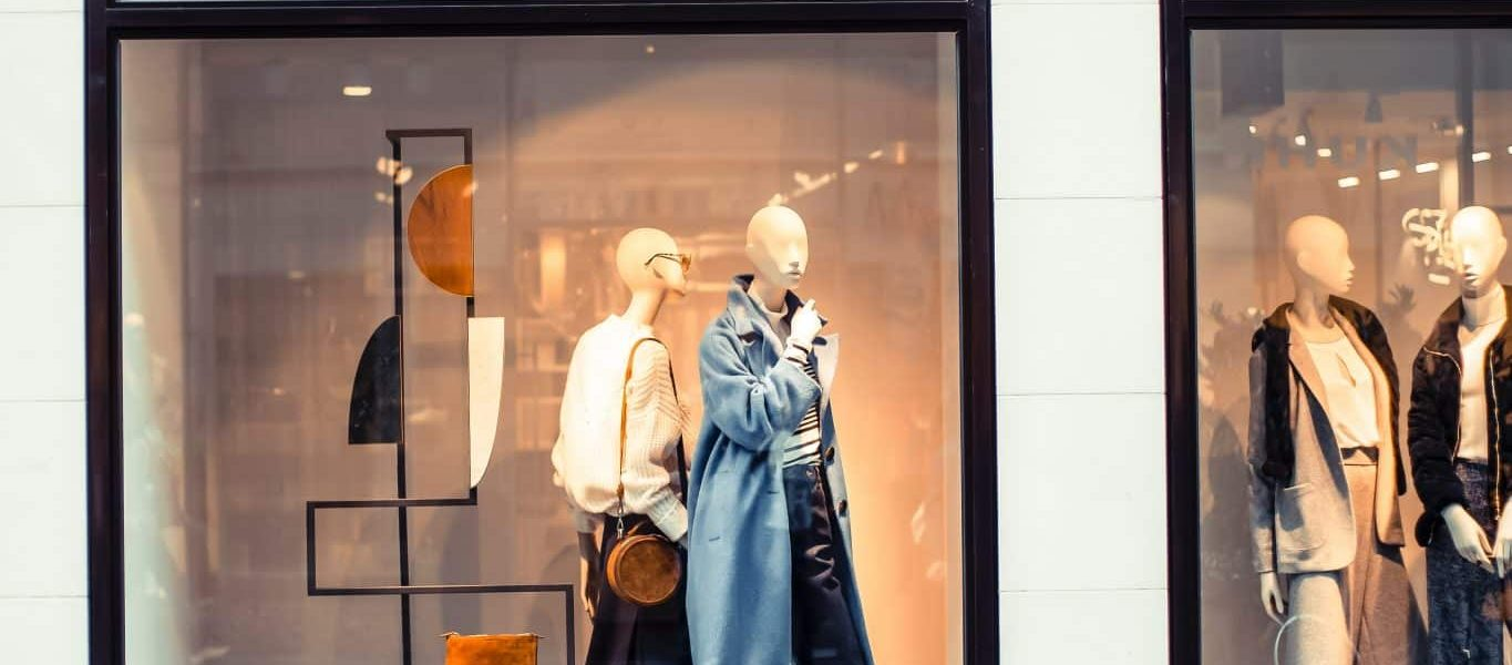 display of mannequins with dresses inside the building