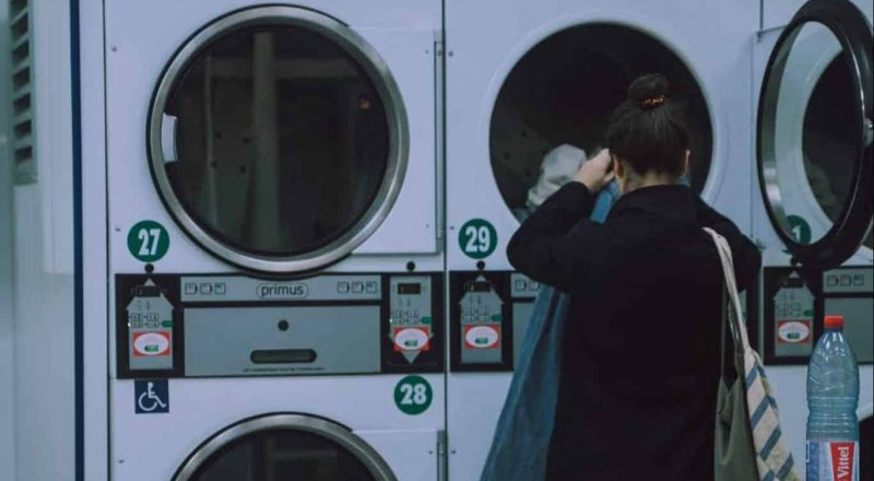 woman washing her clothes photograph