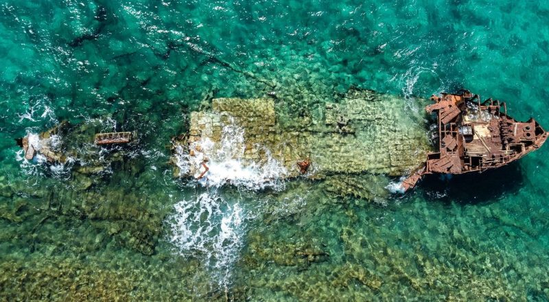 aerial photography of abandoned boat in body of water during daytime