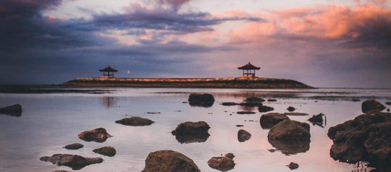 coastal rocks in a distance of nipa hut