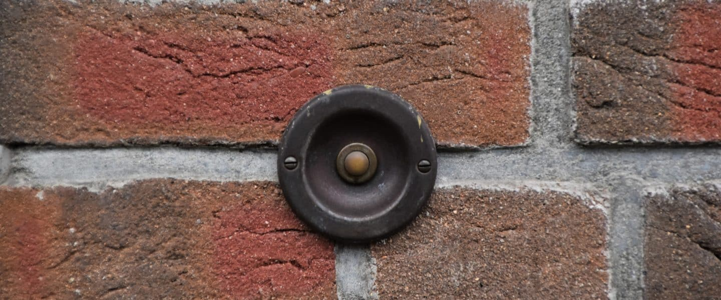 black round metal on brown brick wall