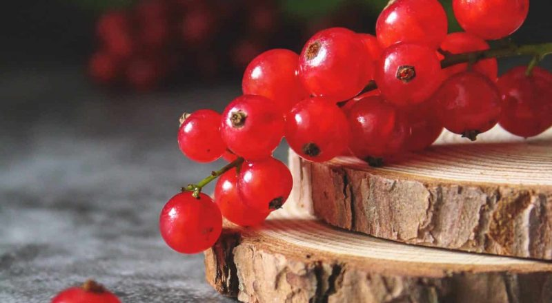 red cherries on brown wooden chopping board