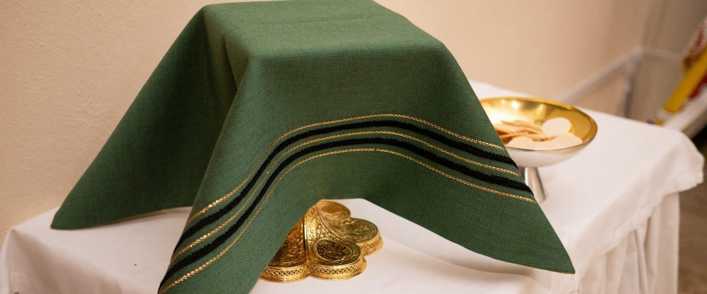 green Holy communion on table