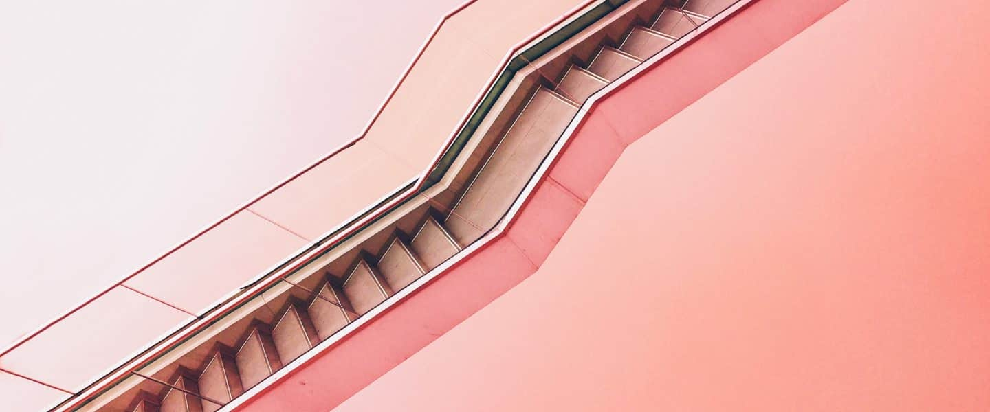 white staircase with pink background