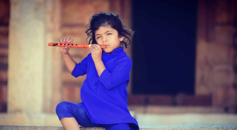 selective focus photography of girl playing flute