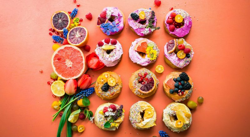 assorted flavor donuts with berries on top