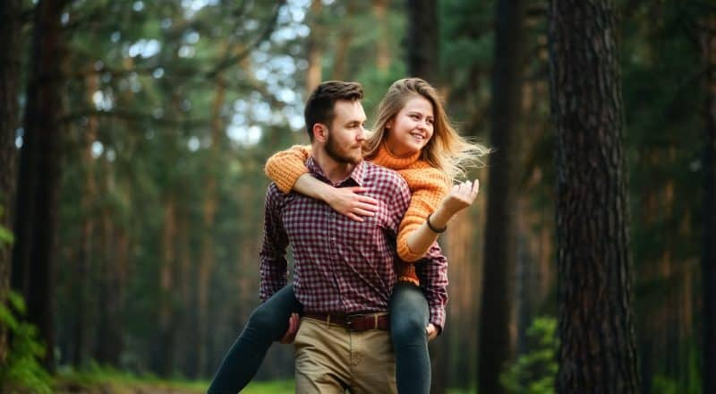 man carrying woman on back